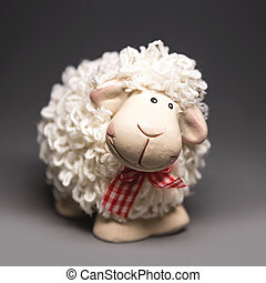White sheep toy the Chinese symbol of 2015 year on gray background
