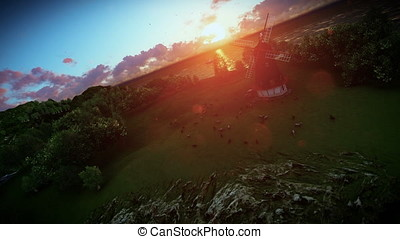 Sheeps on green meadow and windmill at sunset, camera fly 3D