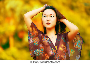 Sheer top - Beautiful Asian fashion model posing in sheer...