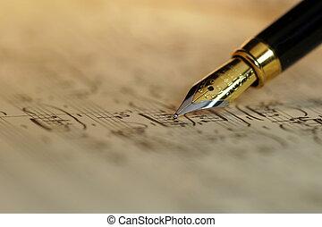 Sheet music and fountain pen