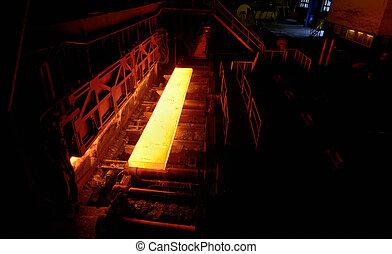 Sheet of hot metal on the conveyor belt