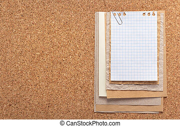 sheet of paper at cork background