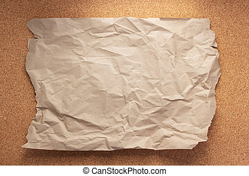 sheet of paper at corkboard as background