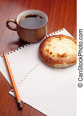 Sheet of paper, bun and coffee