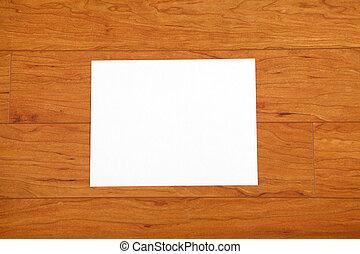 Sheet of paper on the wooden floor