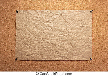 sheet of paper pinned at corkboard as background