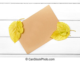 Sheet of paper with autumn leaves.
