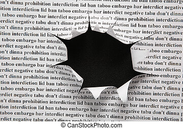sheet of paper with printing text and cut hole against black...