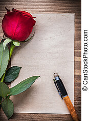 Sheet of paper with scented rose fountain pen holiday concept