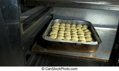 Sheet pan with raviolis in the oven.
