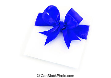 Sheet with blue holiday bow on white background
