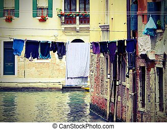 drying laundry on the Canal full of water in Venice