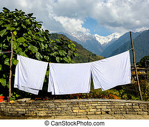 Sheets drying in the sun