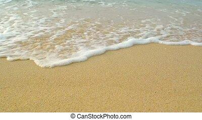 Sheets of Foamy Sea Water Rolling over Coarse Sandy Beach....