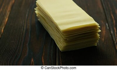 Sheets of lasagna in stack - Closeup of stacked uncooked...