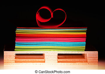 Sheets of paper - Colourful sheets of paper and a heart on...