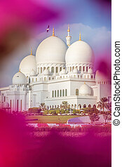 Sheikh Zayed Grand Mosque with flowers in Abu-Dhabi, United Arab Emirates
