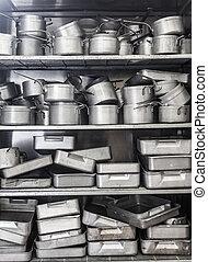 Shelf full of pots all in chrome