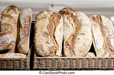 Shelf in the shop with various loafs, italian bread