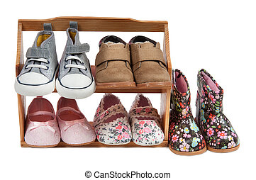Shelf of children shoes for all occasions isolated on white background