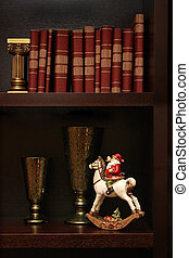 Shelf with a figure of Santa Claus on a horse