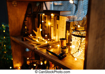 shelf with books decorated with garlands
