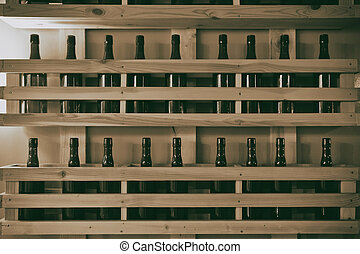 Shelf with bottles on the wall