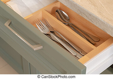 Shelf with cutlery in the kitchen with a new design.