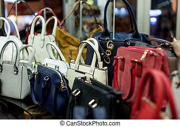 Shelf with fashion bags