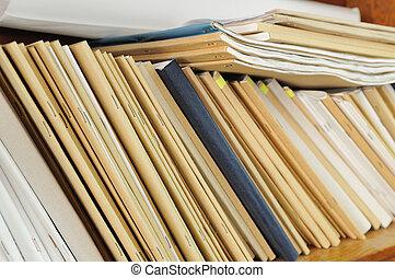 Shelf with file folders - Wooden shelf with file folders,...