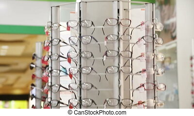 Shelf with modern, beautiful, colored glasses - eye glasses...