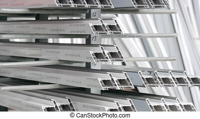 Components of PVC windows. - Shelf with profile blanks for...
