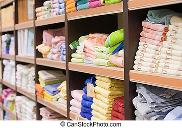 Shelf with towels in a supermarket