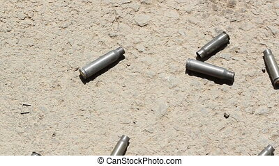 Shell casings. Handheld shot. - Handheld shot of shell...