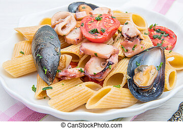 shell dish with pasta and seafood