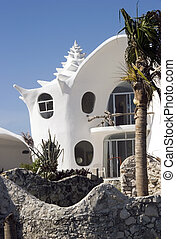 Shell house - A house made in the shape of a sea shell in...