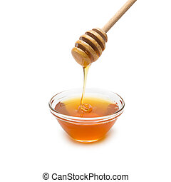 shell with honey and honey dipper - Honey running down from...
