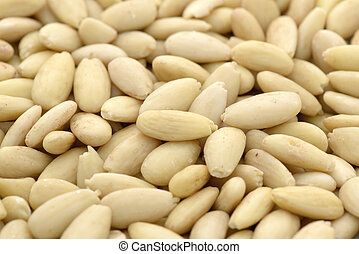 Close-up of shelled and blanched almonds kernel to use as background