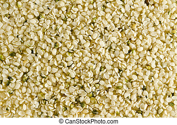 Shelled hemp seeds. Can be used for background. This seeds are Canadian and have their shells removed. Hemp seeds are often called Super Food because of their high content of nutrients