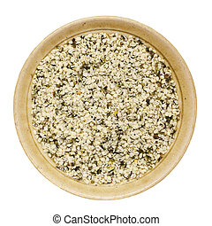 shelled hemp seeds in a round ceramic bowl isolated on white