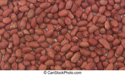 Shelled peanuts. - Close up of shelled Peanuts rotating on...