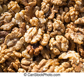 Pile of shelled walnuts for sale at a market to be used for cakes or cooking