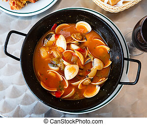 Shellfish broth Almejas a la marinera - Tasty seafood dish...
