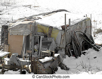 Shelter barracks for the homeless in the snow