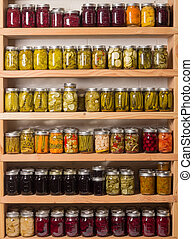 Shelves of canned goods - Shelves of homemade preserves and...