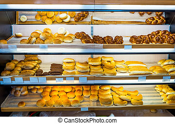 shelves with bread in the bakery