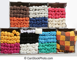 shelves with cotton balls in a haberdashery shop