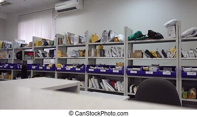 Shelves with parcels in the post office nobody