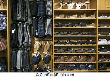 shelves with shoes and accessories in clothes shop