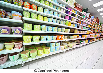 Shelves with variety colorful of clay flowerpot inside large...